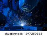 welder erecting technical steel.... | Shutterstock . vector #697250983