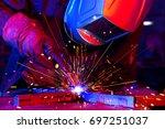 welder erecting technical steel.... | Shutterstock . vector #697251037