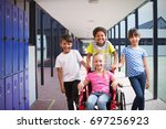 cute disabled pupil smiling at... | Shutterstock . vector #697256923