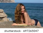 the beautiful girl sunbathes at ... | Shutterstock . vector #697265047