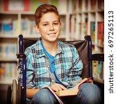 portrait of disabled schoolboy...   Shutterstock . vector #697265113