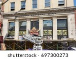 Small photo of NASHVILLE, TN, USA - APRIL 14, 2017: Nashville Opry Originals store sign being dismantled. The store on Broadway street was an iconic presence in a historic building and was permanently closed.