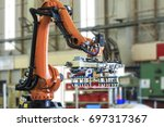 industrial picking robot in... | Shutterstock . vector #697317367