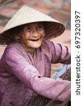 vietnamese woman says hello in... | Shutterstock . vector #697320397