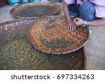 drying green tea in pan... | Shutterstock . vector #697334263