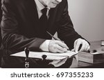 businessman writing testament... | Shutterstock . vector #697355233