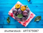 plums. fresh juicy plums in a... | Shutterstock . vector #697375087