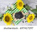 sunflower seeds and oil | Shutterstock . vector #697417297