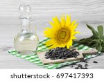 sunflower seeds and oil | Shutterstock . vector #697417393