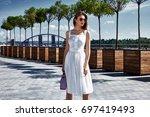beautiful woman walk on the... | Shutterstock . vector #697419493