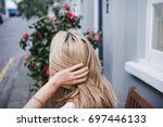 blonde hair. blonde woman. back ... | Shutterstock . vector #697446133