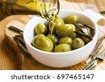 green olives in olive oil ... | Shutterstock . vector #697465147