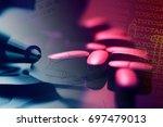 pills scattered on a glass... | Shutterstock . vector #697479013