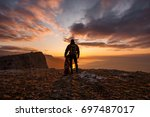 Silhouette Of Young Man With...