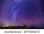 beautiful spiral startrail at... | Shutterstock . vector #697500673