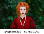 woman with red hair and red... | Shutterstock . vector #697518643