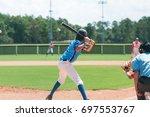 youth baseball boy standing at... | Shutterstock . vector #697553767