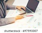 serious business man working at ... | Shutterstock . vector #697593307