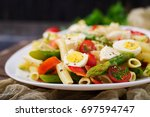 salad   penne pasta with... | Shutterstock . vector #697594747
