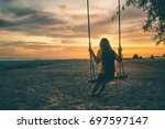 the silhouette of a lonely... | Shutterstock . vector #697597147