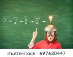 portrait of child in classroom. ... | Shutterstock . vector #697630447