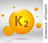 vitamin k2 gold icon.... | Shutterstock .eps vector #697646653