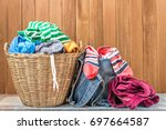 clothes in a laundry basket on... | Shutterstock . vector #697664587