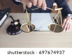 close up of hand male lawyer... | Shutterstock . vector #697674937