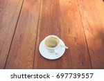a cup of coffee on the wood... | Shutterstock . vector #697739557