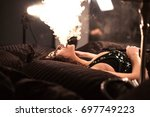 sexy woman smoking hooksh.... | Shutterstock . vector #697749223