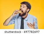 man on a yellow background... | Shutterstock . vector #697782697