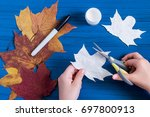 making ghosts from maple leaves ... | Shutterstock . vector #697800913