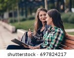 teen girls wandering around the ... | Shutterstock . vector #697824217