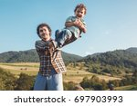happy father and son having fun ... | Shutterstock . vector #697903993