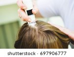 hair doctor checking hair.... | Shutterstock . vector #697906777