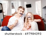 joyful father and daughter with ... | Shutterstock . vector #697984393