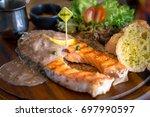 salmon steak black pepper with... | Shutterstock . vector #697990597
