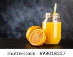 jar of orange juice   Shutterstock . vector #698018227