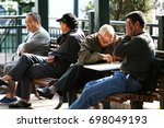 Small photo of HONG KONG, CHINA - FEB 3 2009: Local retired elderlies play Chinese chess and chat in Hoi Sham Park