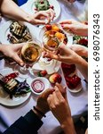 glasses of white wine seen... | Shutterstock . vector #698076343