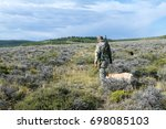 Hunter With Dog Walking Throug...