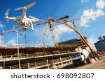 drone over construction site.... | Shutterstock . vector #698092807