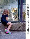 tiger and little girl face to... | Shutterstock . vector #698103043