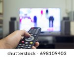 hand holding tv remote control...   Shutterstock . vector #698109403