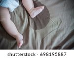 child's feet wet the bed and... | Shutterstock . vector #698195887
