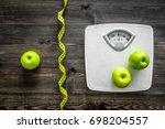 lose weight concept. bathroom... | Shutterstock . vector #698204557