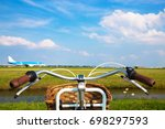bicycle and aircraft takes off. ... | Shutterstock . vector #698297593