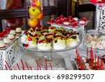 dessert table for a party.... | Shutterstock . vector #698299507