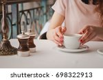 the girl drinks coffee in a... | Shutterstock . vector #698322913