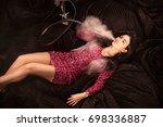 slender girl smoking hookah and ... | Shutterstock . vector #698336887